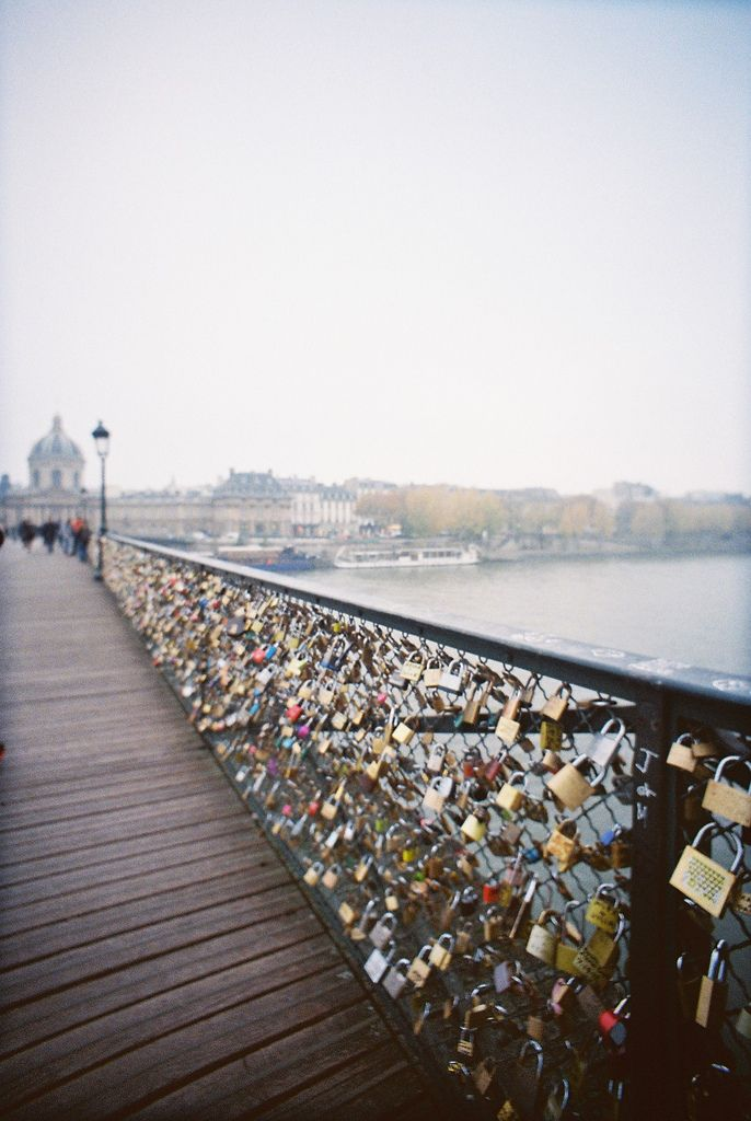 A bridge in Paris that lovers attach a lock then throw the keys into the water with their names or initials engraved on the lock; locked forever♥