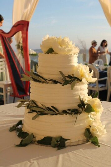 Wedding cake-olive leaves and white peony, wedding in santorini,  wedding planner,  wedding destination,  wedding in greece, reception party www.santoweddingsbymk.com
