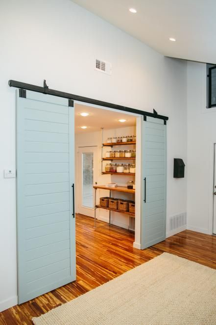 Back downstairs, the couple was also given a sleek addition to their space—a former mudroom was converted into this butler's pantry with barn doors painted in a beachy blue. See more from this episode.