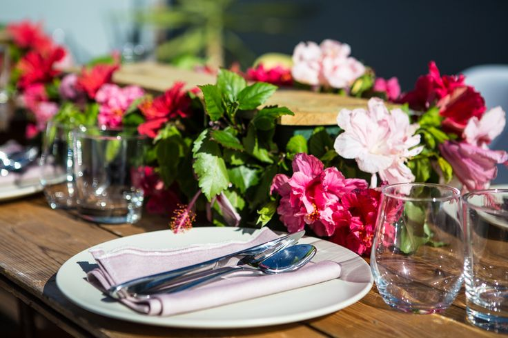 Summer hibiscus hedge tablescape for a tropical rooftop dinner party   Styled by The Inventory for The Lazy Susan Lunch Club, January Rooftop Dinner Party 2015  #hibiscus #tropical #tablescape #pink