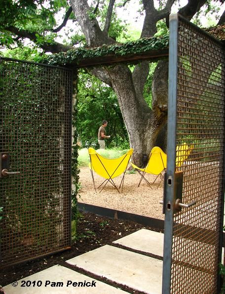 Love the mesh gates, gravel, butterfly chairs, pavers, lots of green...