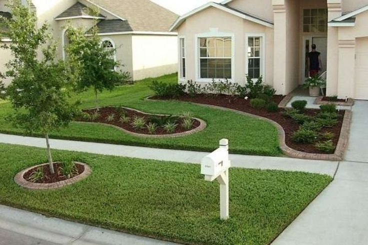 Front Yard With Small Concrete sidewalk thru w wavy plantg islands
