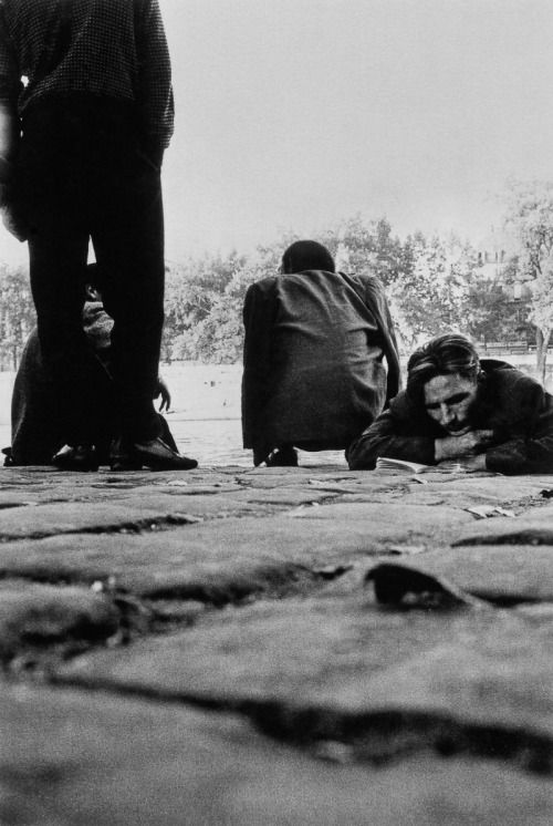 """""""I often carry things to read so that I will not have to look at the people."""", Charles Bukowski.  Homeless people, Paris, 1959.  [original]© Sergio Larrain. Magnum Photos, from Sergio Larrain: 'Vagabond Photographer'."""