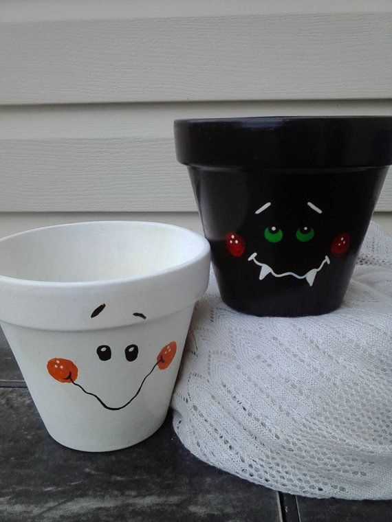 Check out this item in my Etsy shop https://www.etsy.com/listing/205154571/halloween-decor-clay-pot-ghost-and
