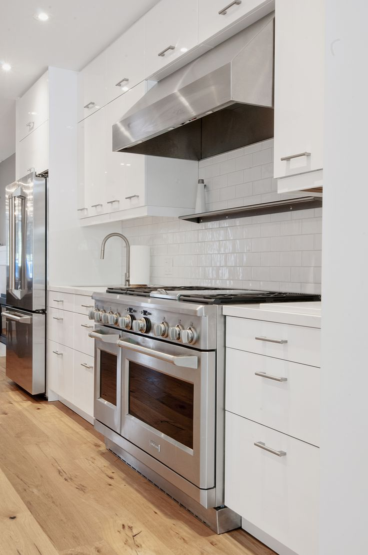 Modern Rustic Makeover. Customized Ikea kitchen with Caesarstone counter. Sandra Brzezinski Photography.