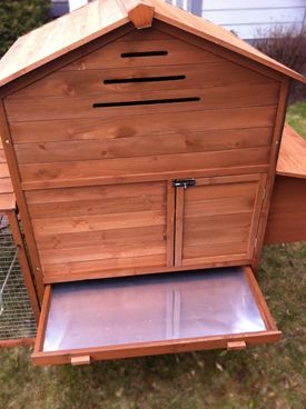 Great idea--pull out shelf under roost for easy clean up.  Coop My Chicken | The Manor
