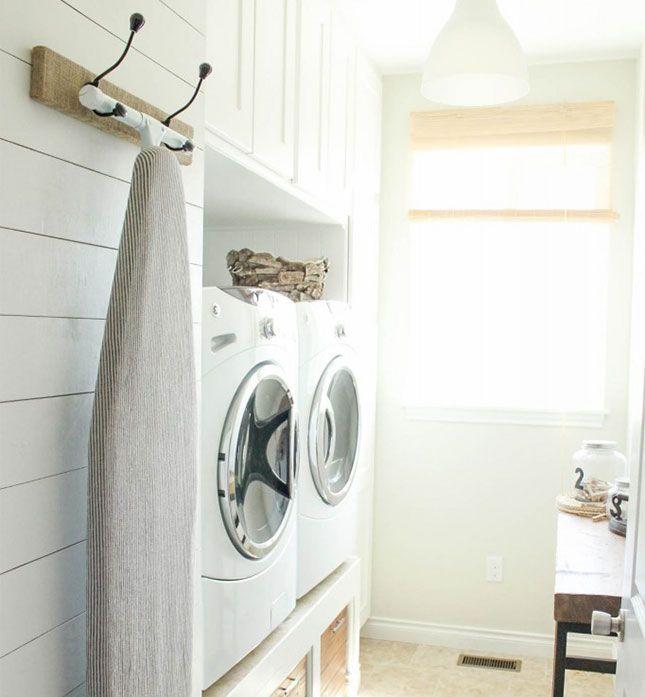 Hanging Ironing Board Rack, 20 Laundry Room Organization Ideas via A Blissful Nest