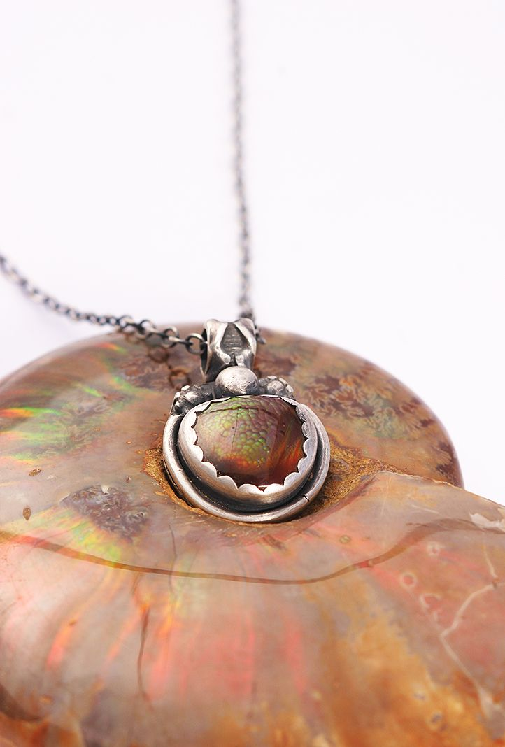 Artisan jewelry: Arizona Fire Agate pendant in sterling silver by Lisa Marie Morrison of Sirocco Design. Photo Pablo Rivera.