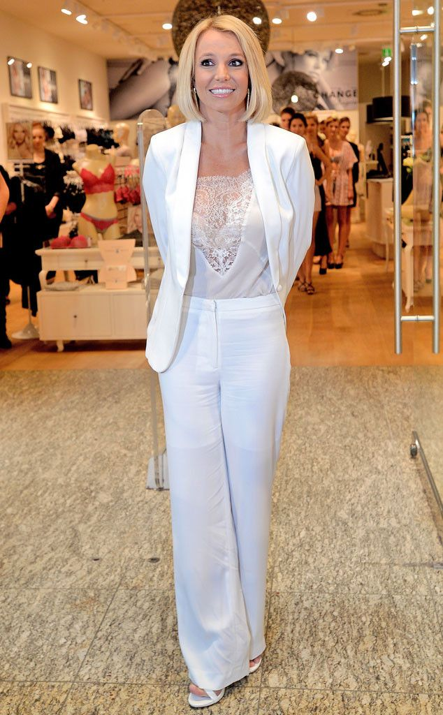 Britney Spears is a professional-looking mother of two in this all-white ensemble by Michael Costello! Although if you look more closely, she does maintain a slight racy factor with that sheer Maje cami underneath.