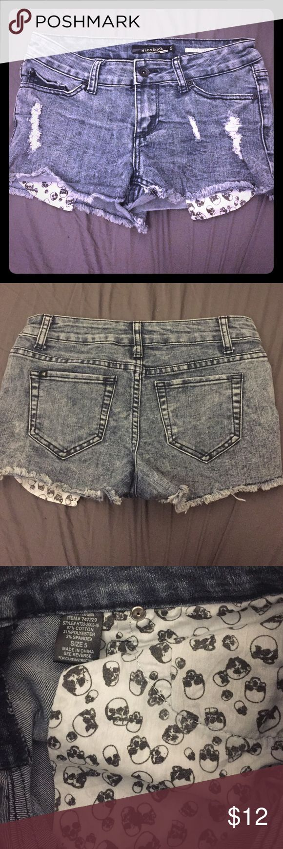 Acid Wash Shorts with Skull Pockets Worn for a season but still in great condition. Size 5. The pockets have a skull design and is meant to peek out when wearing the shorts. Hot Topic Shorts