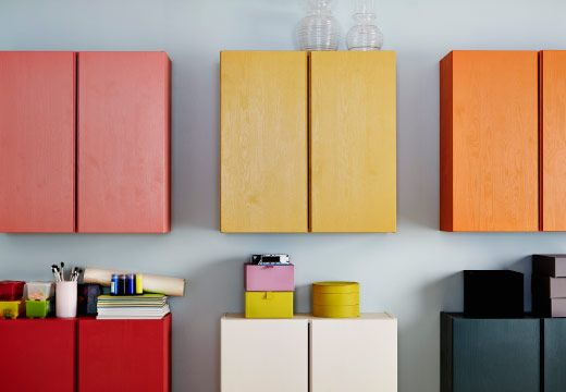 A wall of IVAR storage cabinets painted in different colors