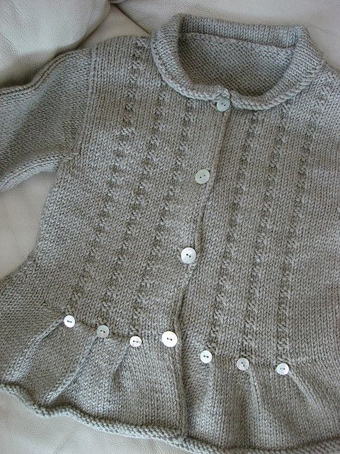 Brambling from Rowan Little Knits-very pretty roll  collar baby cardigan, flare hem, button detail, stitch vertical open work