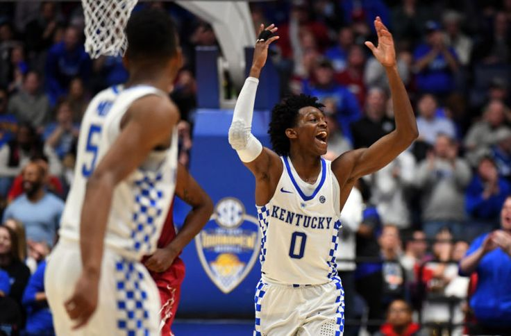 Mar 11, 2017; Nashville, TN, USA; Kentucky Wildcats guard De'Aaron Fox (0) reacts after making a basket during the second half against the Alabama Crimson Tide during the SEC Conference Tournament at Bridgestone Arena. Kentucky won 79-74. Mandatory Credit: Christopher Hanewinckel-USA TODAY Sports