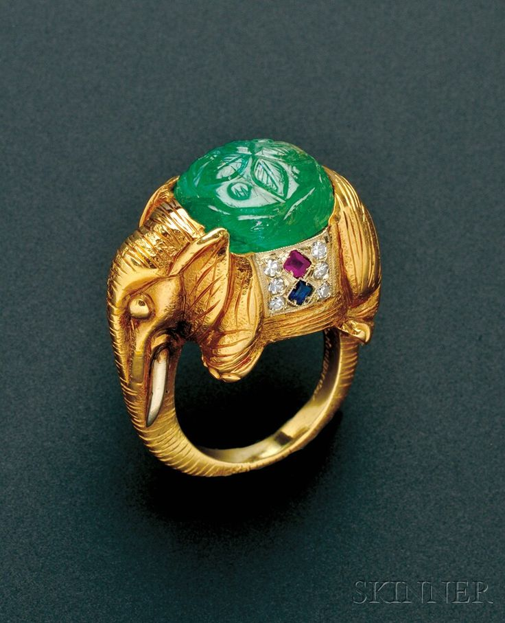18KT GOLD, CARVED EMERALD, AND GEM-SET ELEPHANT RING, CARTIER. SET WITH A CARVED EMERALD CABOCHON, FANCY-CUT RUBY AND SAPPHIRES