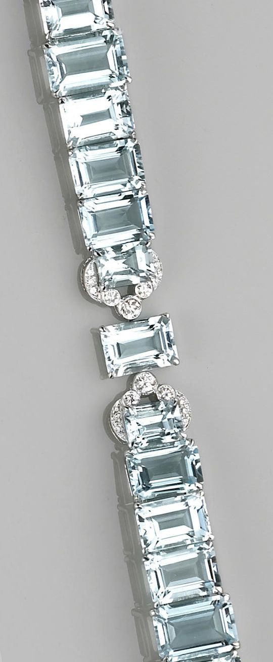An aquamarine, diamond and eighteen karat white gold bracelet  the flexible bracelet designed with single prong-set emerald-cut aquamarine links, completed by stations set with round brilliant-cut diamonds; estimated total aquamarine weight: 64.10 carats; estimated total diamond weight: 1.05 carats; length: 6 7/8in.