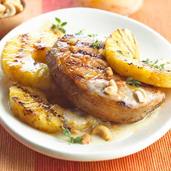 Orange marmalade creates a sweet glaze that tops this Grilled Pork and Pineapple. More healthy dinner recipes: http://www.bhg.com/recipes/healthy/dinner/cheap-heart-healthy-dinner-ideas/?socsrc=bhgpin091413porkpineapple#page=4
