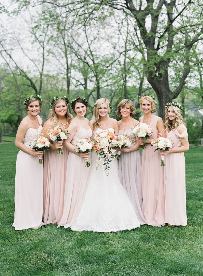 whimsical spring wedding with mix and match bridesmaids dresses in shades of blush and lavender   bridesmaids wore floral crowns in addition to carrying bouquets