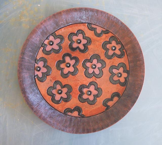 Terracotta flower and button plate