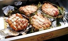 "Luau Pork Shoulders in ""La Caja China"" Roasting Box"
