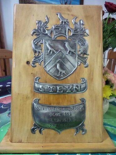 Hand crafted Pewter art family crest on solid wood stand