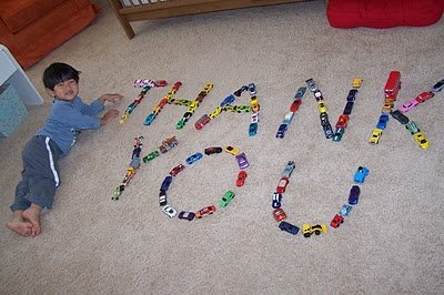 """Make a personalized photo thank you card using something that really is a """"part"""" of the child -- for Drew -- Definitely Legos!"""