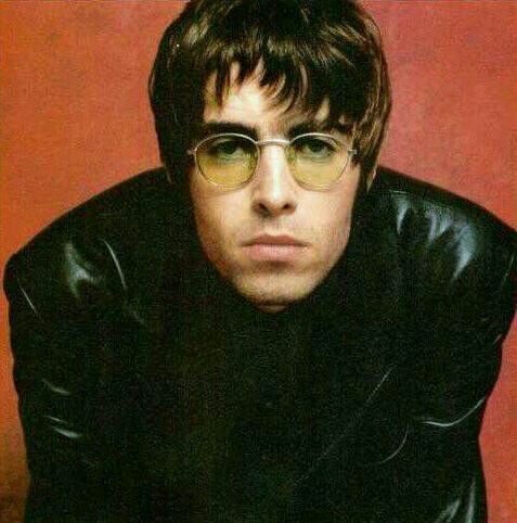 Liam Gallagher- Leather Jacket and Lennon Sunglasses.