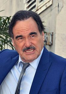 """Oliver Stone Cannes 2010.jpg. April 1967, Stone enlisted in the Army, requesting combat duty in Vietnam. He served September 1967-November 1968 with 25th Infantry Division, then with 1st Cavalry Division, earning Bronze Star with """"V"""" device for heroism in ground combat; wounded twice & received Purple Heart with Oak Leaf Cluster. He also received the Air Medal for participating in more than 25 helicopter combat assaults and the Army Commendation Medal…"""