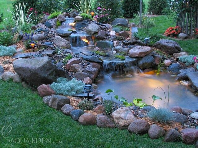 Backyard pond with multiple waterfalls