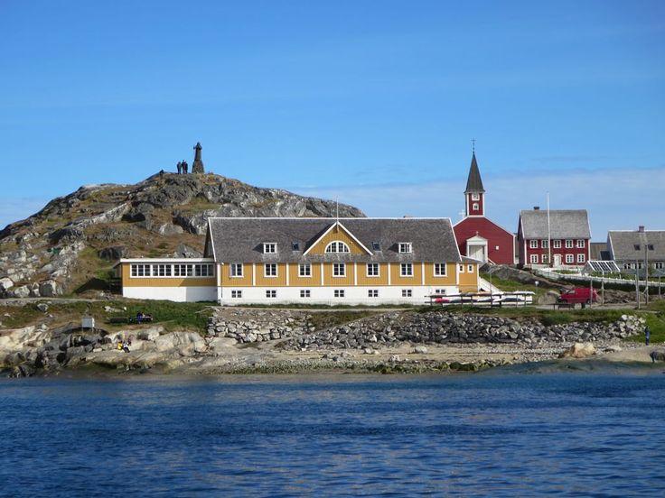 Picturesque buildings overlook Kolonihavnen, the old colonial harbor of Nuuk, Greenland.