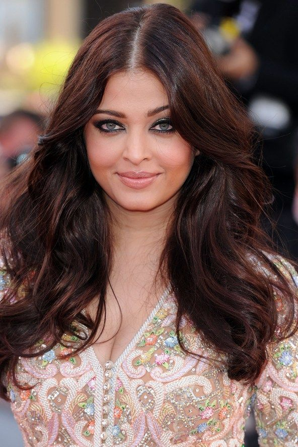 Cannes Film Festival 2013: Aishwarya Rai Bachchan's hair was styled in glamorous, centre-parted waves for the Blood Ties premiere, while her make-up focused upon heavily-lined eyes and flushed cheeks.