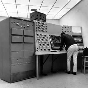 1965 analog computerA 1965 analog computer at SCU's school of engineering looms over its human programmer. Courtesy of Santa Clara University's Dept. of Archives & Special Collections