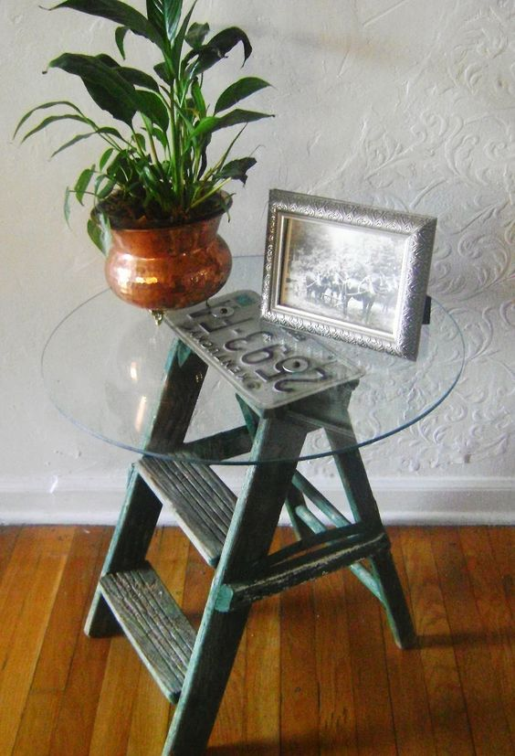 Go treasure hunting: Take a look through your garage or storage space to see if any old items can be repurposed. How about sanding and painting an old wooden ladder to use for storing blankets and scarves? Small stepladders can also be a fun way to store essential items in place of a traditional side table.
