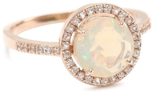 rose gold, huge opal, and a round cut? this is perfection.