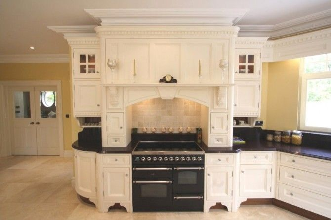 Cream bespoke kitchen in a timeless in-frame shaker style.