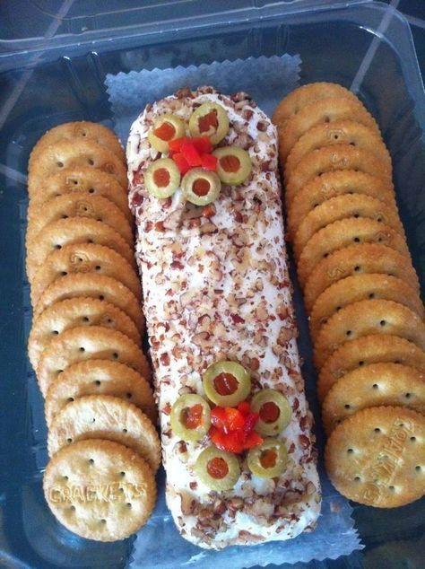 Receta: 1 queso philadelpia 5 rebanadas de jamon o una latita de deviled ham Aceitunas Nuez picada Papel aluminio ... ...