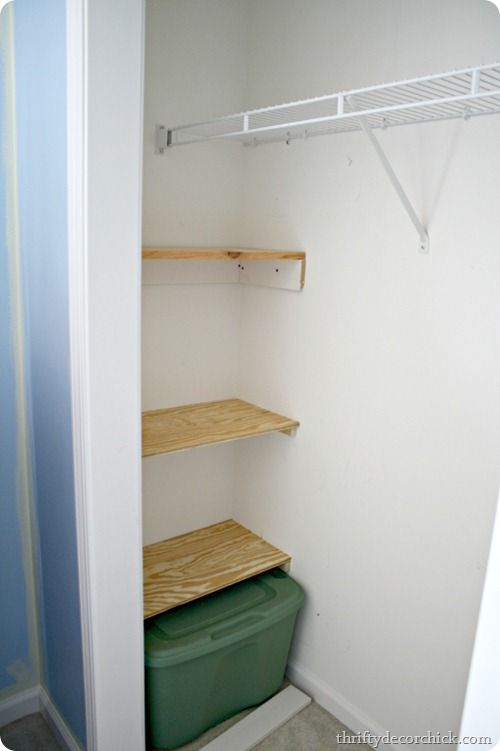 I absolutely cannot stand this wasted corner in long closets - it's so illogical! Abbi's closet is similar, so I'll probably put in similar shelving on the ends to store low-use items.