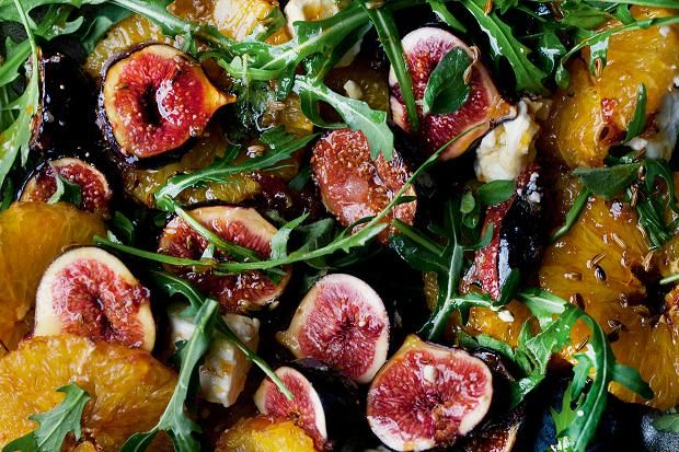 A caramelised fig, orange and feta salad from Yotam Ottolenghi's new vegetarian tome. It includes lightly toasted fennel seeds and is finished by sprinkling with oregano leaves and rocket and serve. Nice.