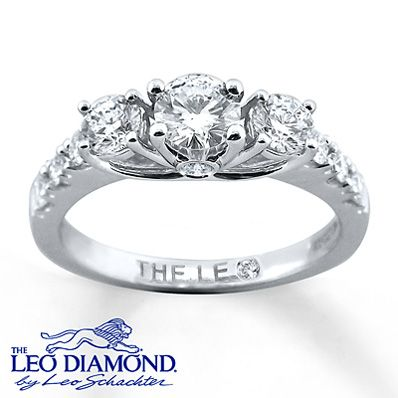 Three spellbinding round Leo diamonds form the center of this amazing engagement ring for her. The 14K white gold band is showered in additional sparkling round Leo diamonds. The ring has a total diamond weight of 1 carat. Independently Certified and laser-inscribed with a unique Gemscribe® serial number.