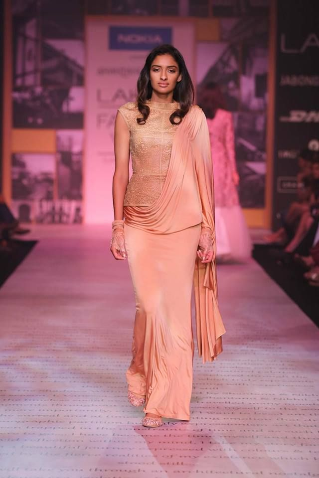 Shantanu & Nikhil Lakme Fashion Week Summer 2014 peach sari lehnga. More here: http://www.indianweddingsite.com/shantanu-nikhil-lakme-fashion-week-summer-resort-2014/