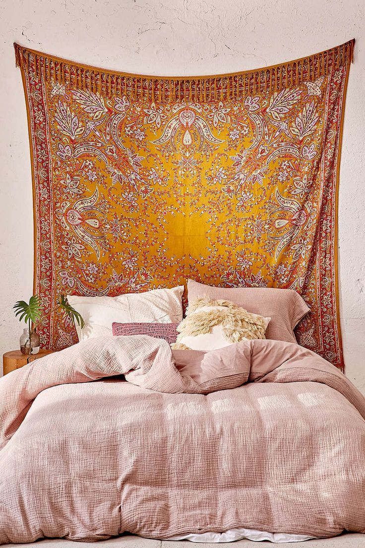 25 Bohemian Bedroom Decor Ideas That Will Make You Want to RedecorateASAP | Gorgeous wall tapestry + a dusty pink duvet | @stylecaster