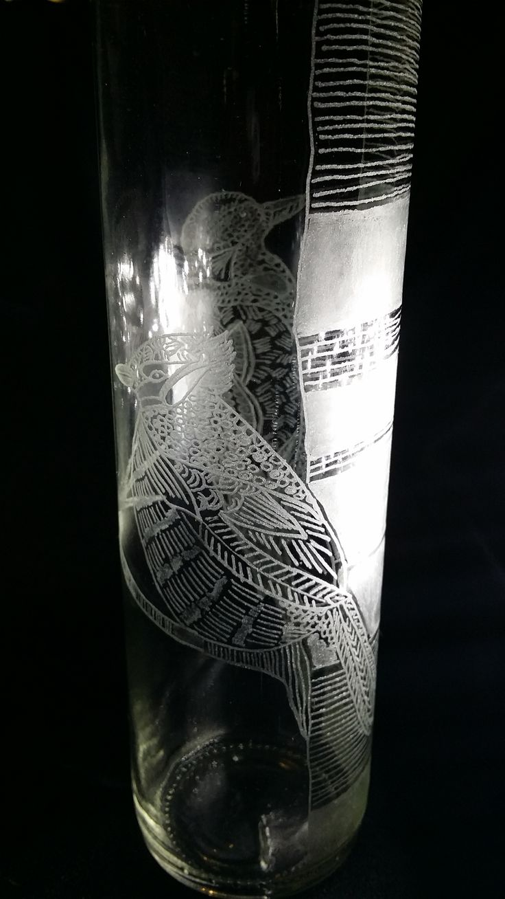 water bottle hand engraved with images of birds