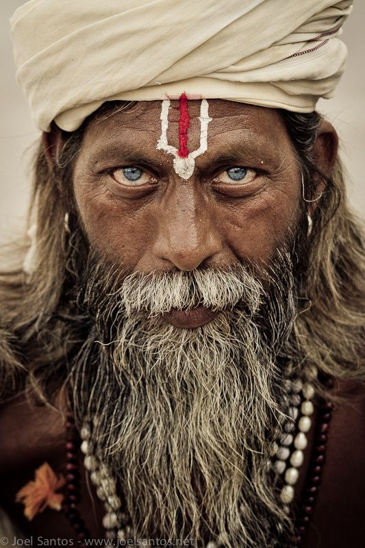 Sadhu, India, male, intense blue eyes, beard, powerful face, expression, man, portrait, photo