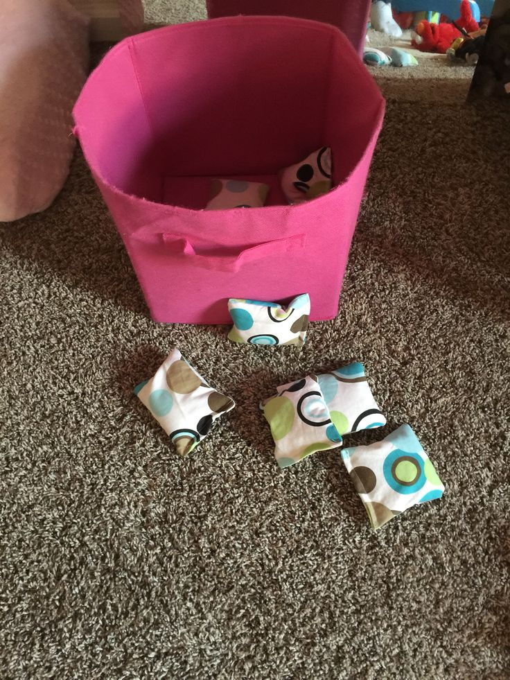 Fun game for Samantha and Cailin made from leftover shower curtain as material and filled with rice! Hours of fun!
