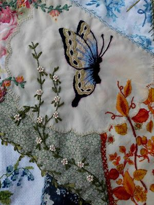 butterfly. I like the continuation of the leaves from the print to the plain fabrics