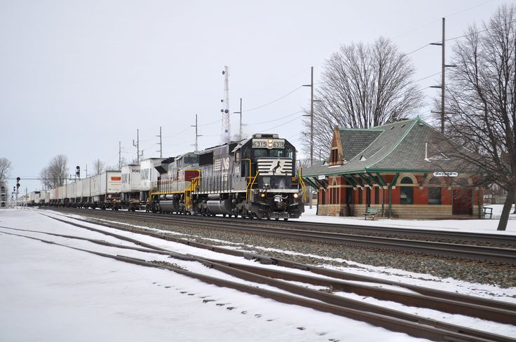 A daily Norfolk Southern intermodal train from Chicago passes the historic Wauseon, Ohio, station, a former Lake Shore and Michigan Railroad depot. Built in 1896, the building now houses railroad memorabilia representing the eight railroads that once traversed the area. February 2016 calendar photo by: Tim Calvin (track foreman in Kendallville, In.) In Ohio, Norfolk Southern has 2,200 miles of track, 1,280 bridges, and 2,630 grade crossings (public and private.)