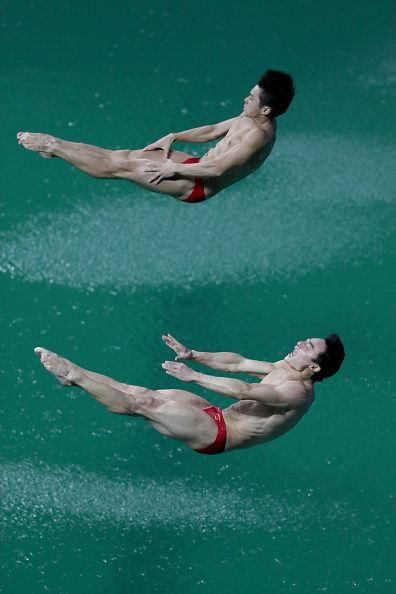 #RIO2016 Yuan Cao and Kai Qin of China compete in the Men's Diving Synchronised 3m Springboard Final on Day 5 of the Rio 2016 Olympic Games at Maria Lenk...