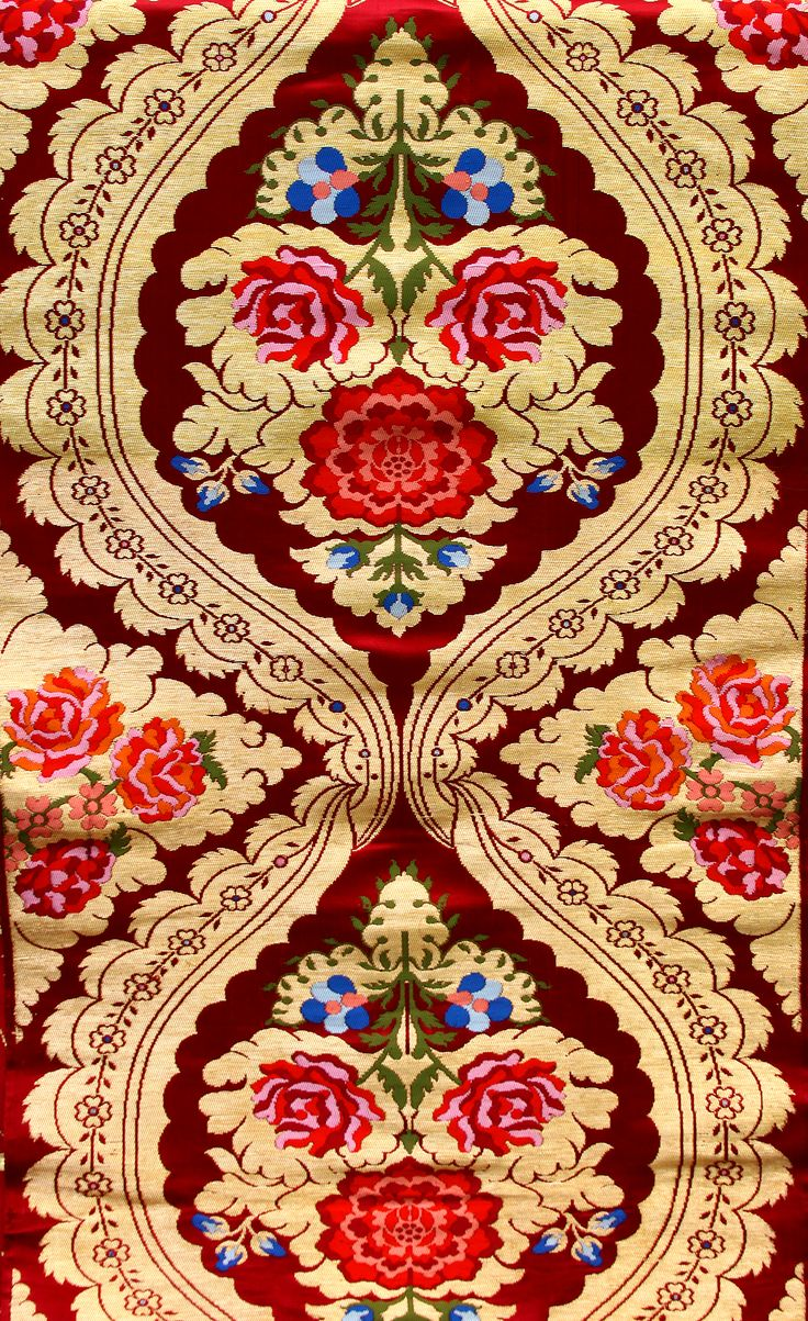Red brocade fabric with woven roses