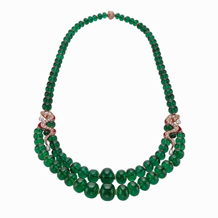 The Bulgari Serpenti emerald neckace with detachable ruby earrings are a perfect display of the stylish jewels this iconic jewellery brand creates. Bvlgari is famous for its use of colour, and this red-carpet-worthy necklace comprises 94 round Zambian emerald beads totalling an incredible 1,021 carats. Discover more: http://www.thejewelleryeditor.com/window-shopping/jewellery-for-her/bulgari-serpenti-emerald-neckace-detachable-ruby-earrings/