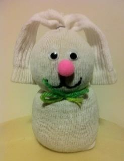 Take one white sock and stuff it with rice. Close off the top with a small rubberband. tie a ribbon around it's neck. Cut down the top of the sock to make ears. Add eyes, and mouth and nose. Makes a cheap and cute Easter decoration for kids. They were made in my school with school age kids.