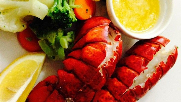 Steamed lobster tails with a hint of beer. Goes great with melted butter, lemon juice and garlic.